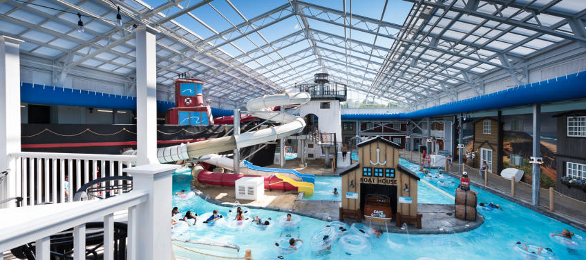 Indoor pool with waterslide  5 Indoor Water Parks for New England Families - Mommy Nearest
