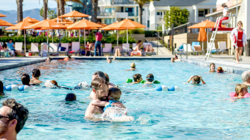 Father Holds Baby In Annenberg Pool Near Los Angeles