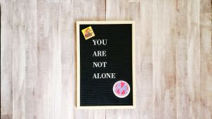 """<a href=""""https://action.momsrising.org/cms/view_by_page_id/13054/?source=action"""">We Are Not Alone. You Are Not Alone.</a>"""