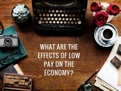 What are the effects of low pay on the economy?