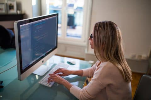 Woman on the computer checking her credit report