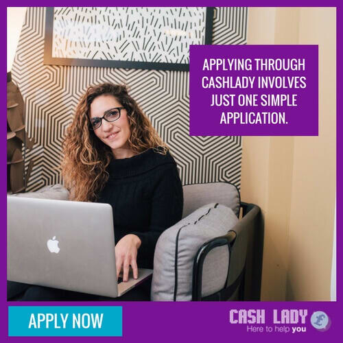 a pretty lady is sitting on the sofa with a laptop trying to apply for a loan