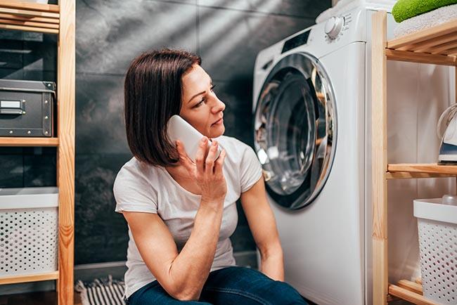 woman applying for a small loan to fix a broken washing machine