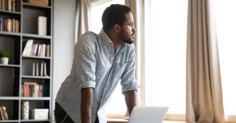 Man researching health care options