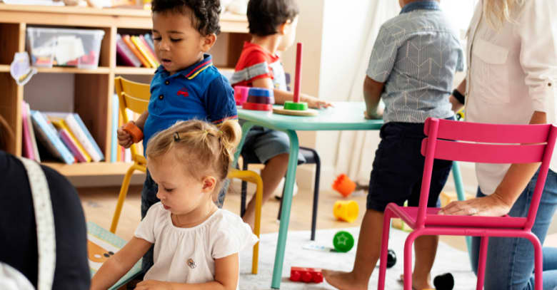 A small group of children engage in learning at a preschool