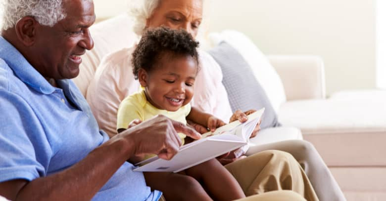 Grandparents enjoy babysitting their young grandchild.
