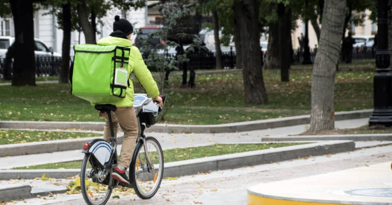 a person delivers food on a bike