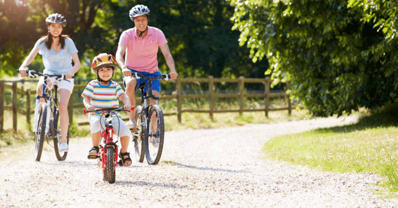 A family is out for a bike ride on a sunny day