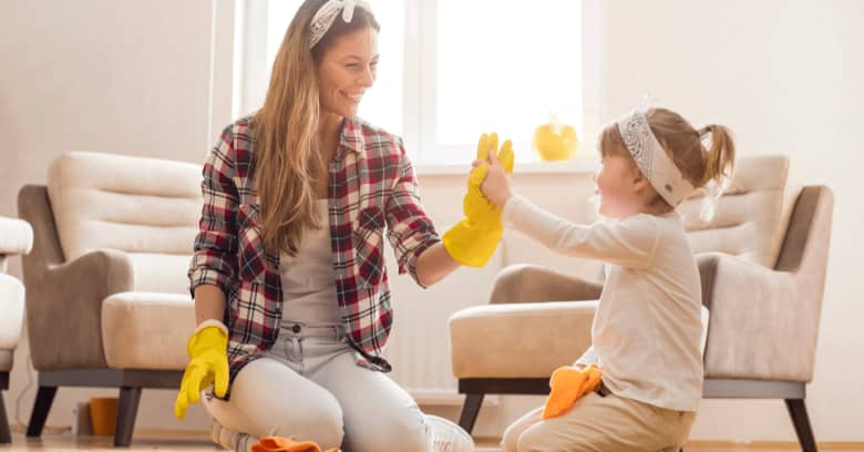 a woman and her daughter enjoy cleaning the house together