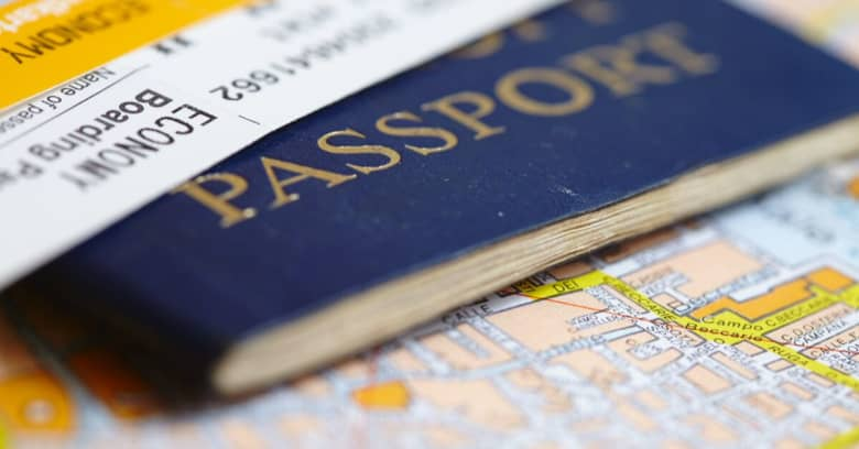 A closeup image of a map, passport and boarding pass.