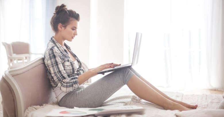 Woman on laptop running her side hustle