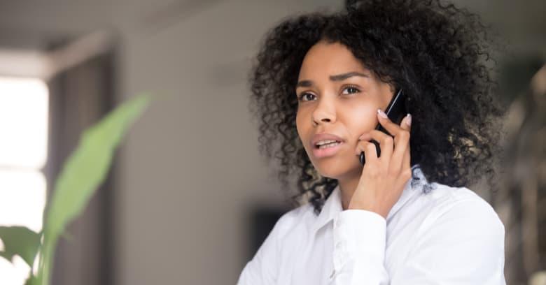 A woman has a serious phone conversation.