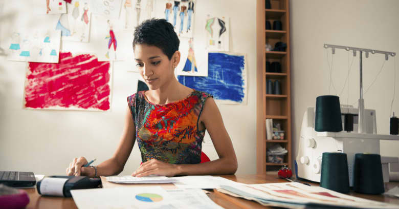 A woman who owns her own home business considers applying for a small business loan, thanks to the favorable interest rates