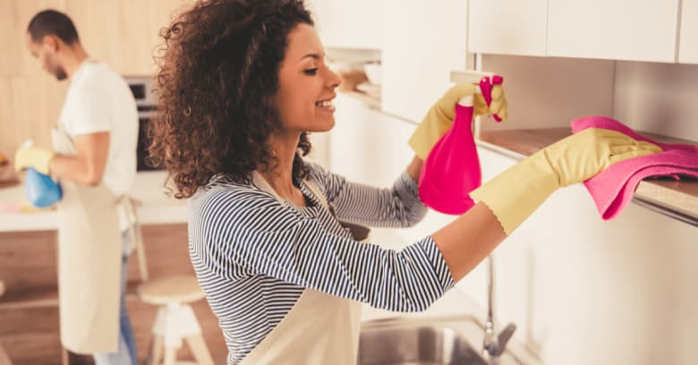 A couple cleans their kitchen
