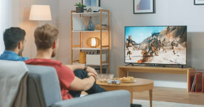 A couple watches TV while observing quarantine rules
