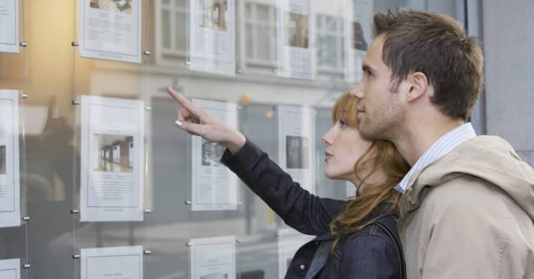 A couple in their 30s looking at homes