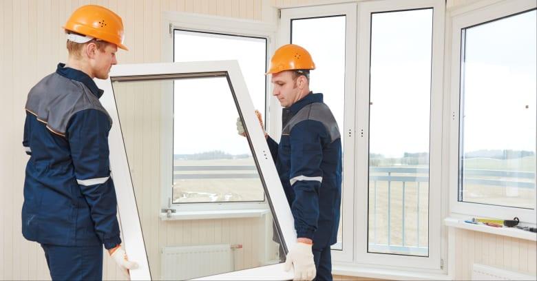 Men replacing windows