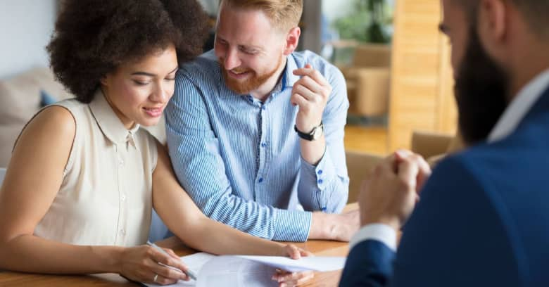 Couple discussing home loans with mortgage lender