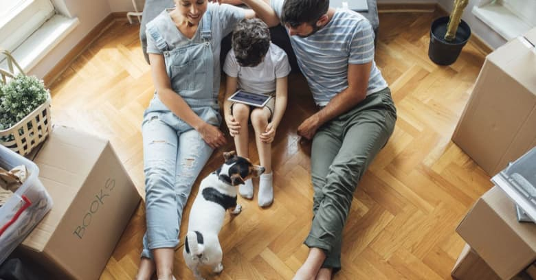 Couple with young son and pet moving into new house