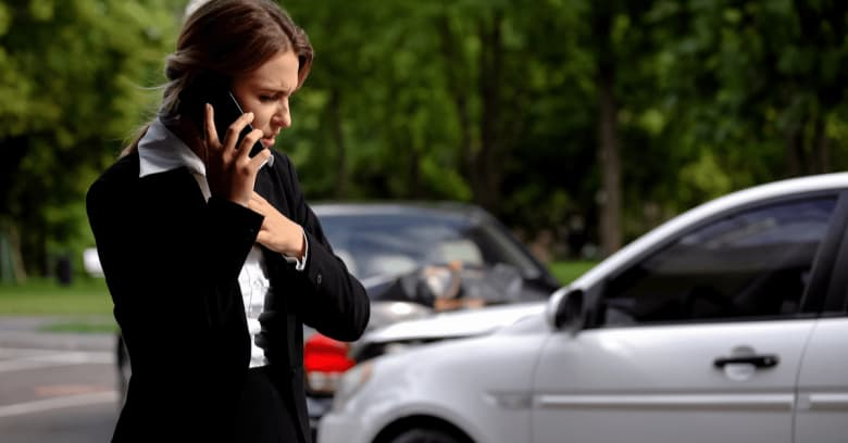 Woman after car accident trying to use her phone to call for help
