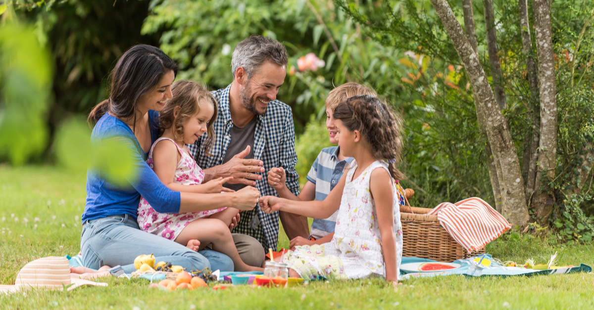 Family enjoying picnic outside