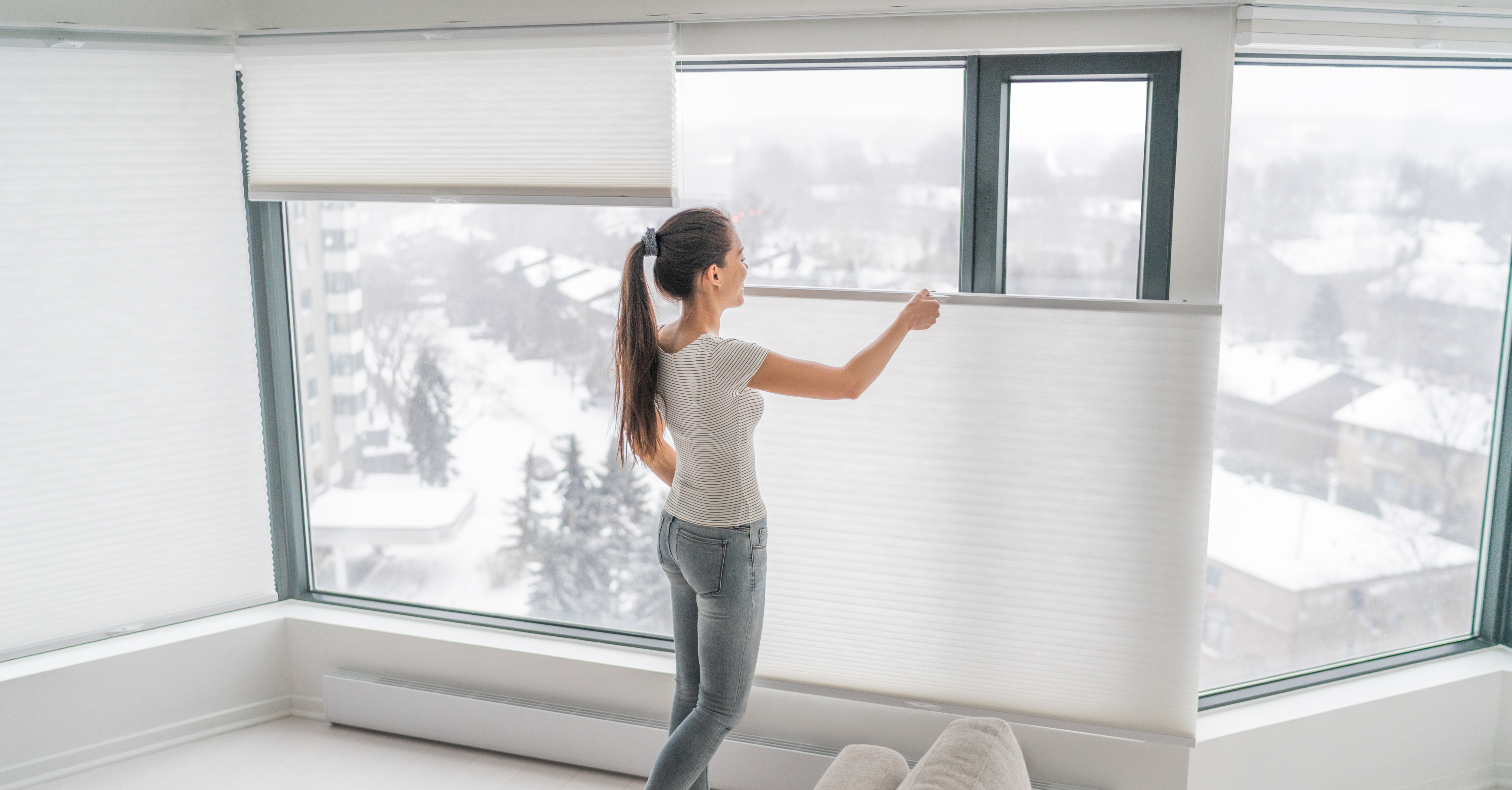 Woman opening new window shades