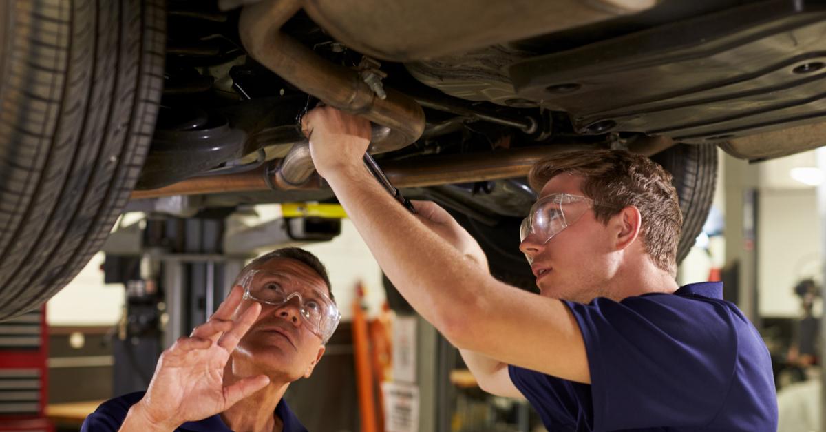 Students preforming car repairs