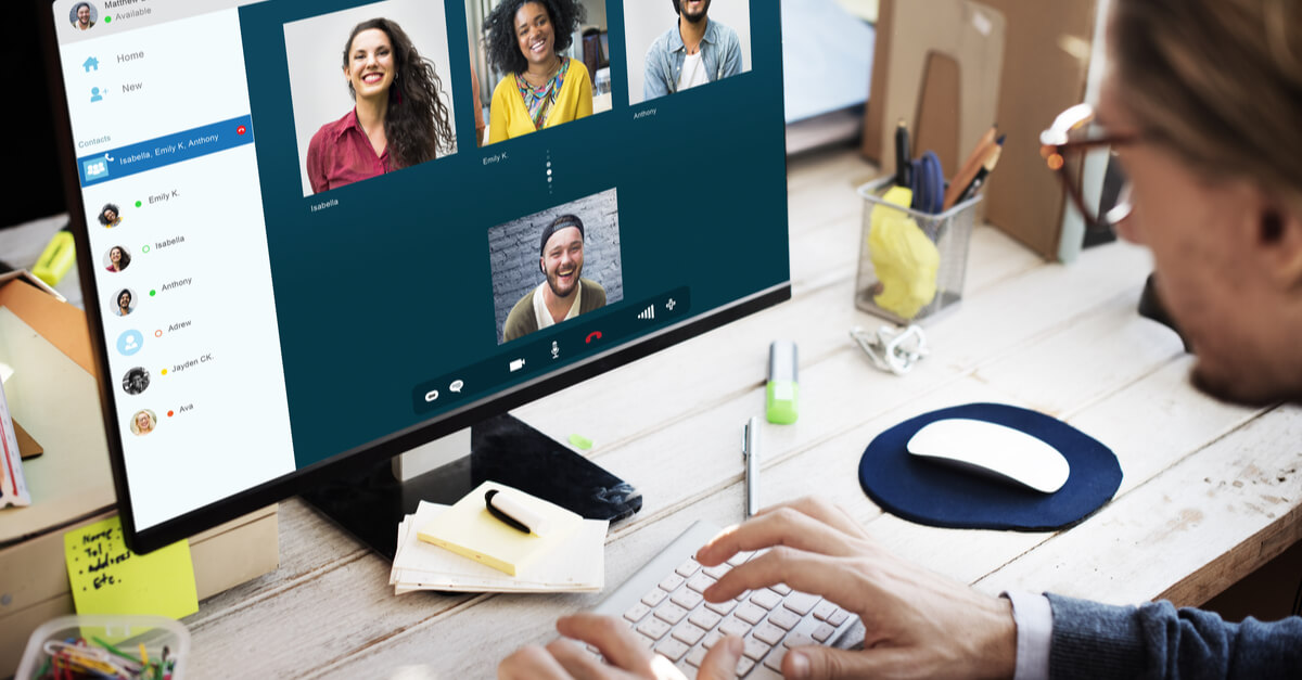 A man video chats with his coworkers as a way to bond while working apart.