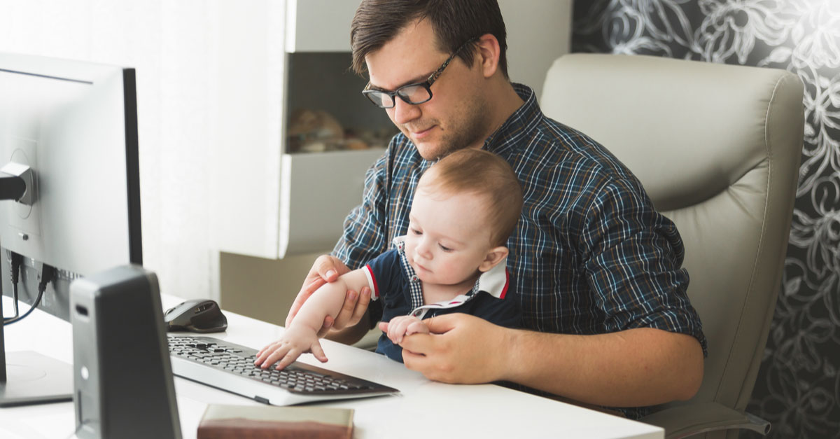 Father and baby at computer working