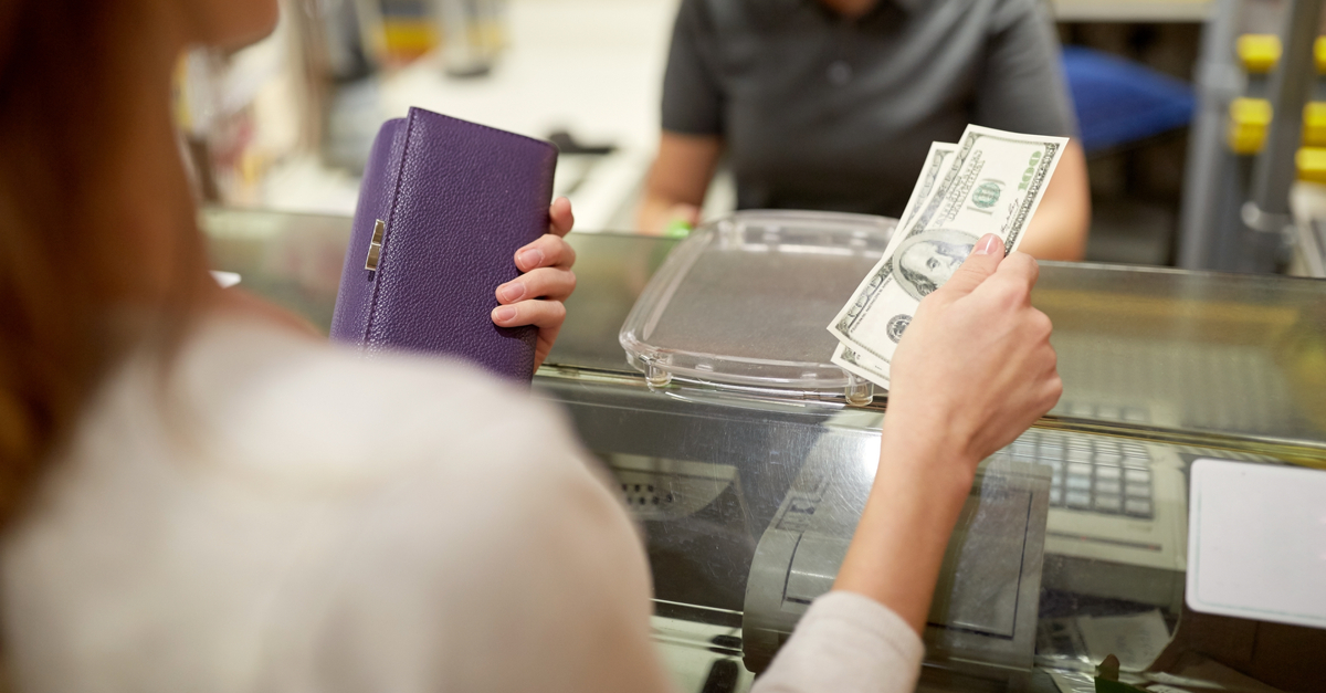 Woman saving change from a transaction