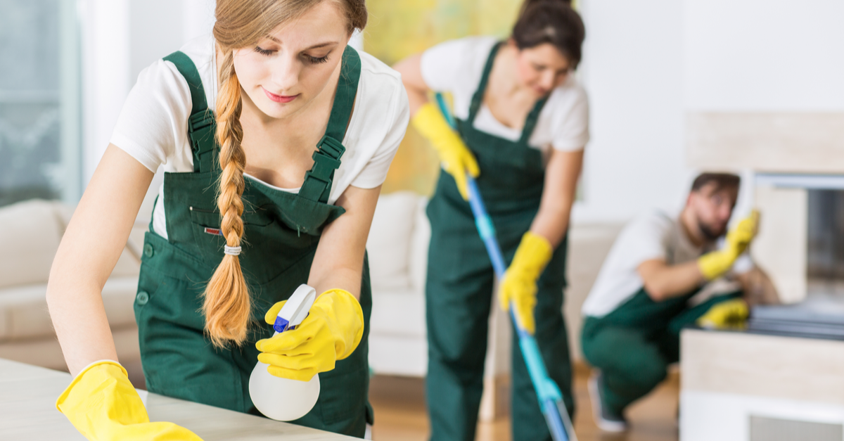 three professional cleaners are shown cleaning a home with proper cleaning equipment