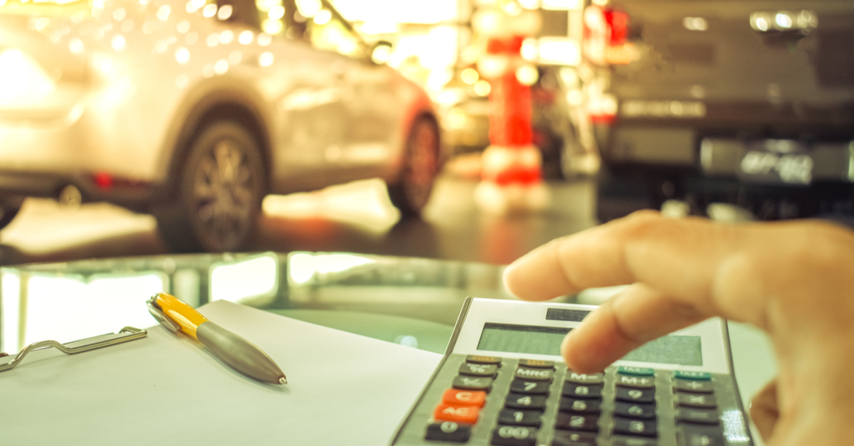 a finance manager at a car dealership figures out how much a car buyer's payments will be