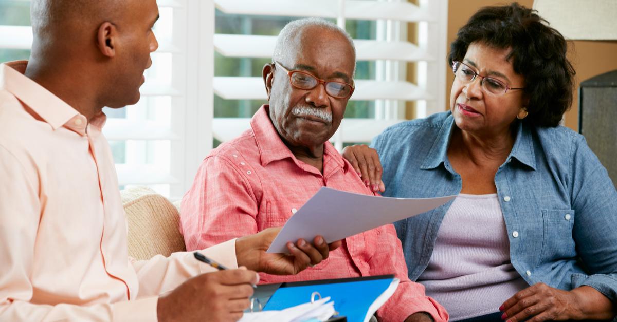 A son helps his senior parents sort through their medical debt.