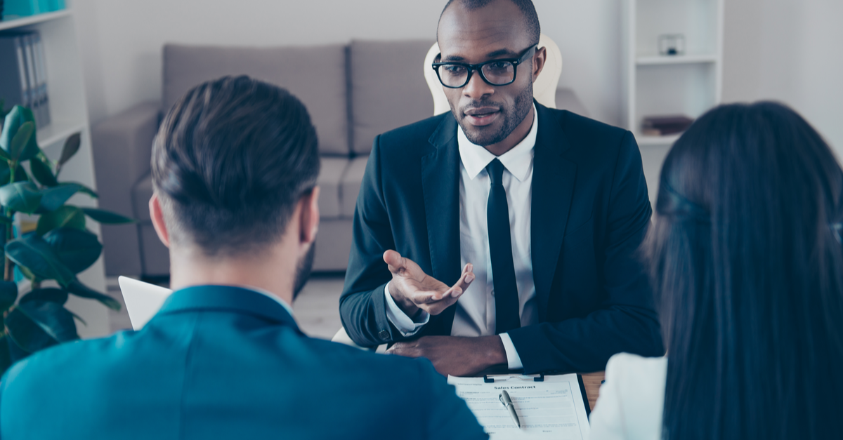 A bankruptcy lawyer meets with clients in his office.