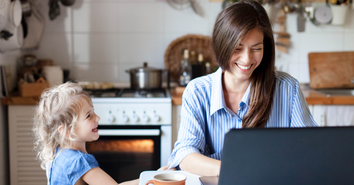 A freelance worker works from home while caring for her daughter.