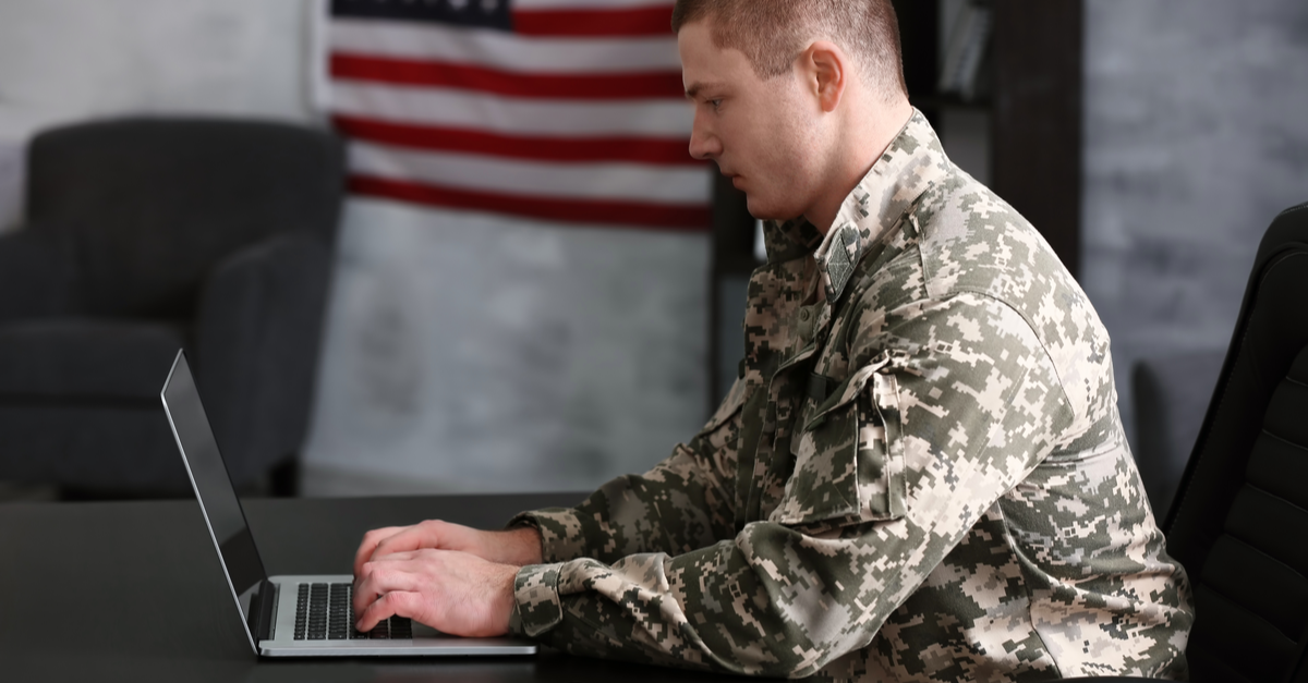 A military man looks for a civilian job on his computer