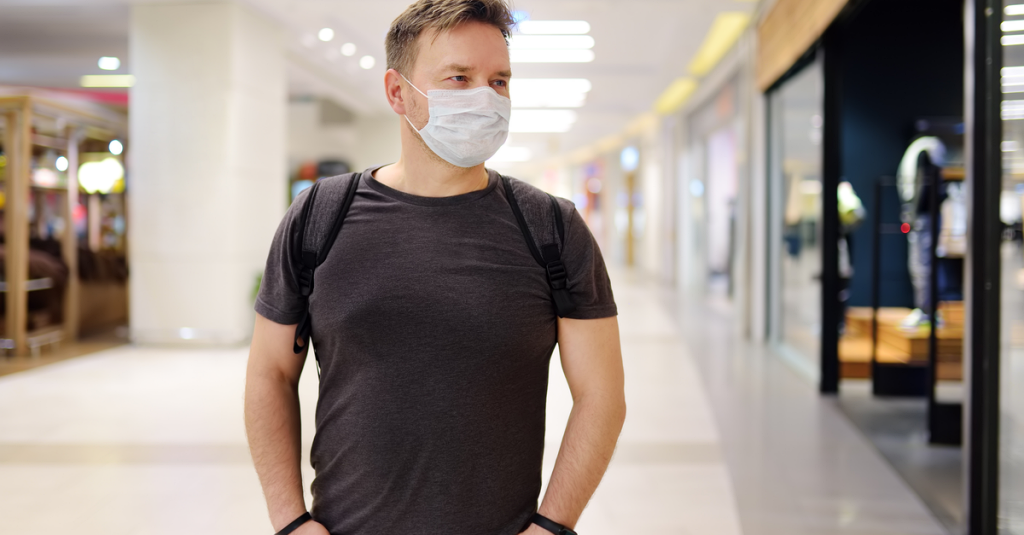 a man in a mask ventures out in public after the coronavirus quarantine