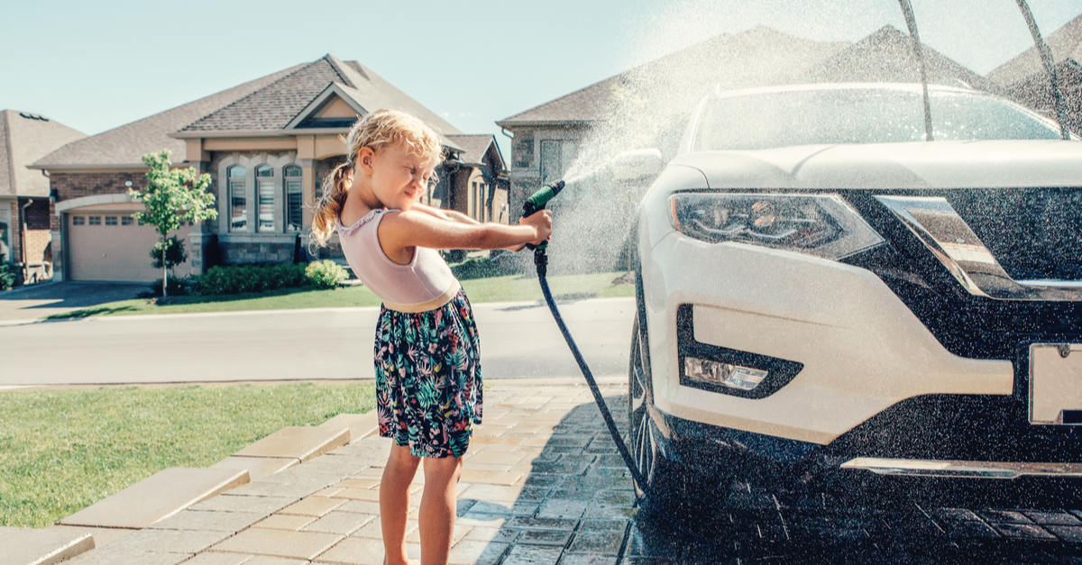 A girl earns allowance by helping wash the family car