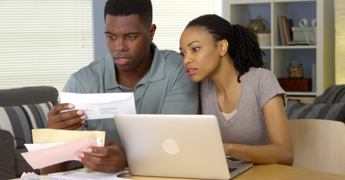 A couple calculates how much money they owe