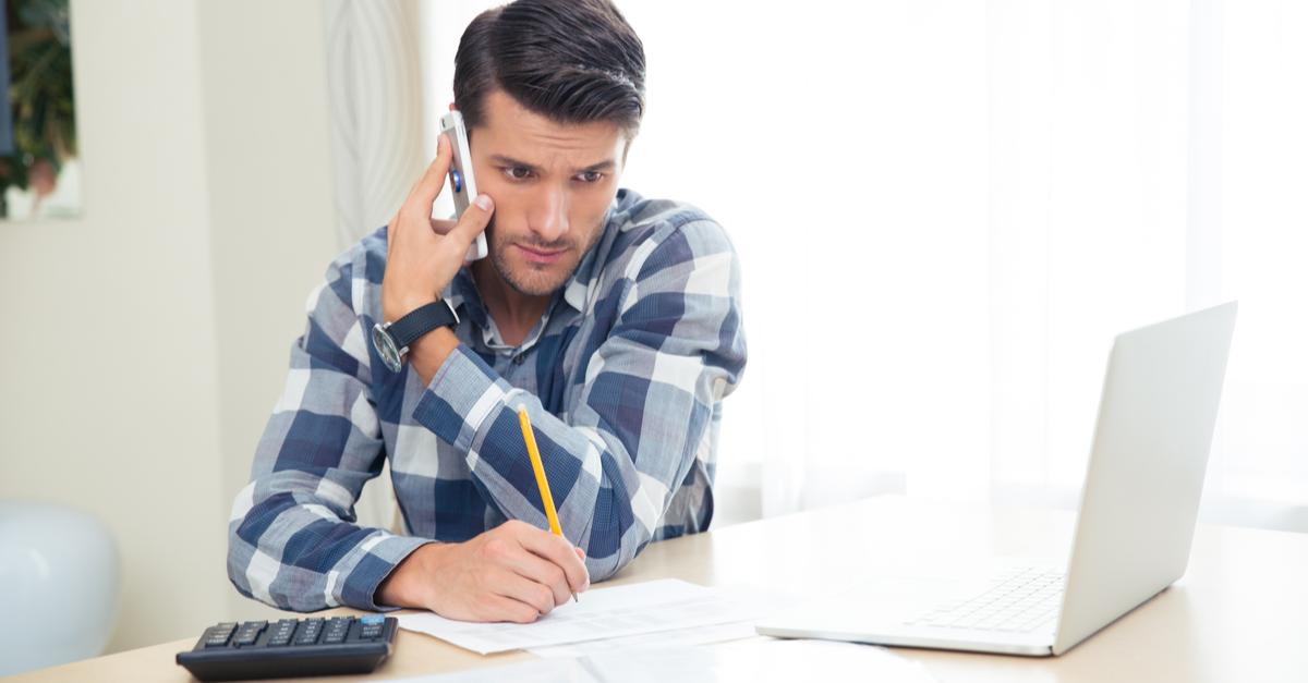 A man calls his creditor to get help paying his bills