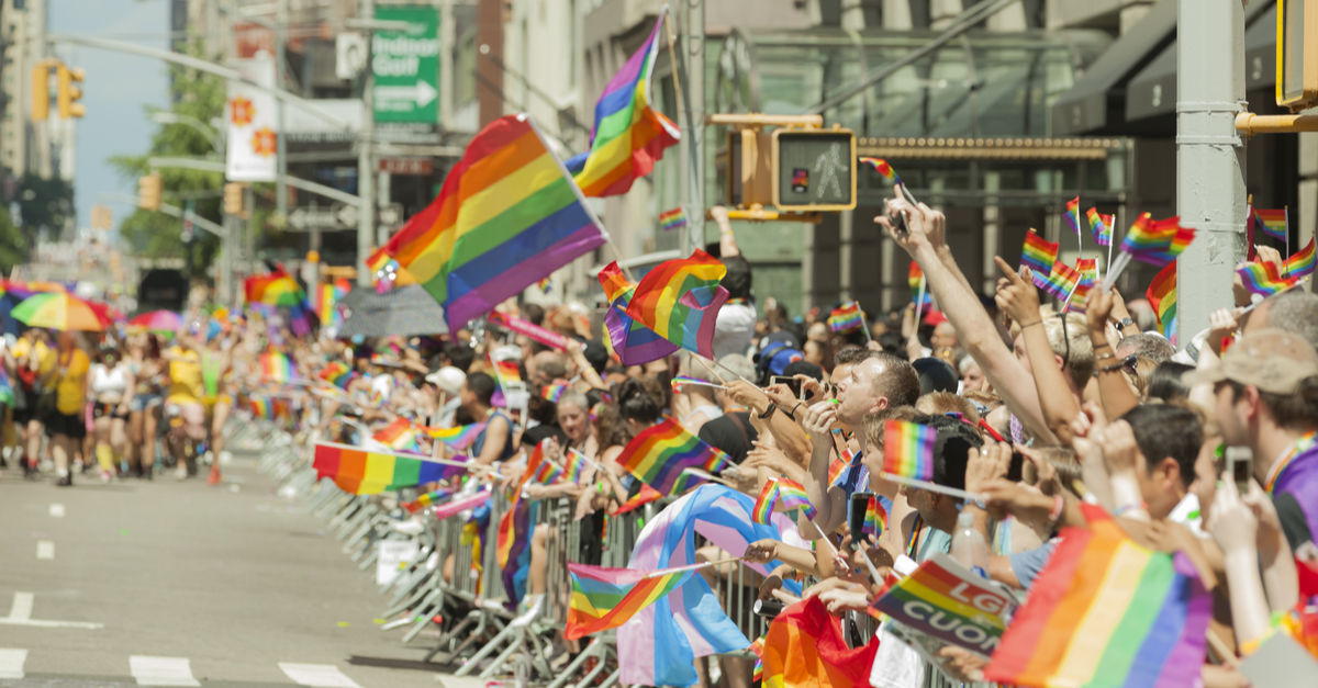 A group of onlookers during a pride parade