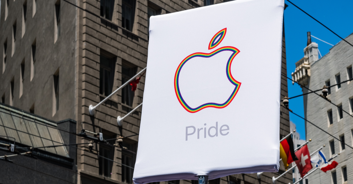 The Apple logo with the word 'Pride' is shown on an outdoor sign