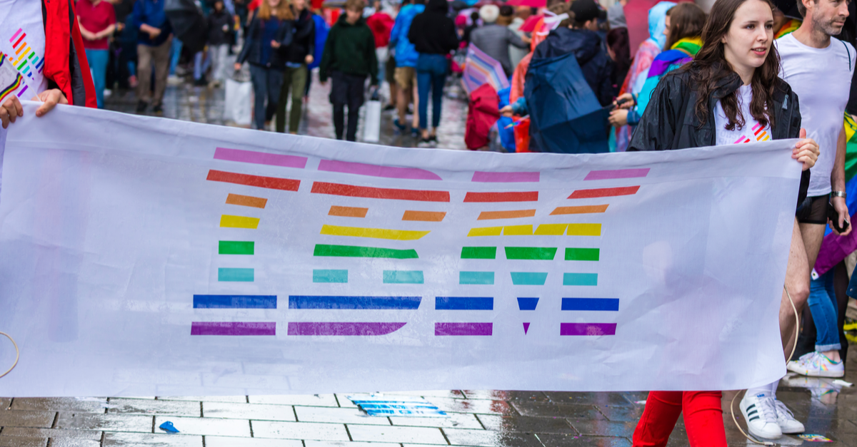An IBM banner is shown at a Pride Month parade