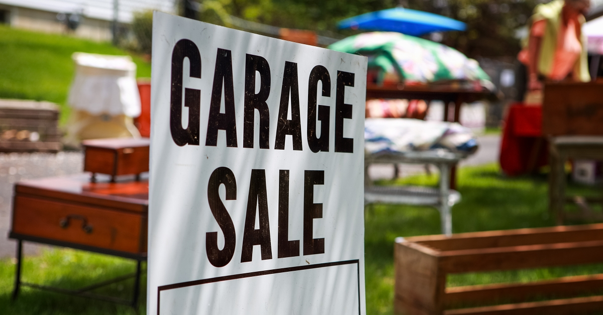Items for a garage sale are assembled in a lawn.