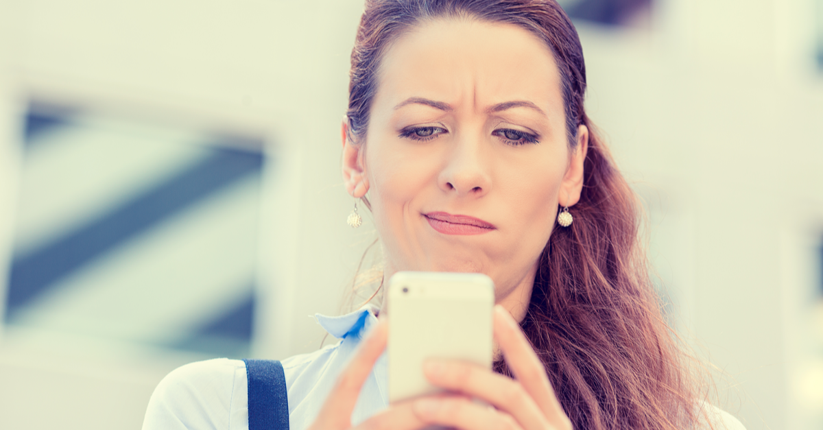 A woman tries to learn more about a charity but she looks skeptical as she ends a phone call.