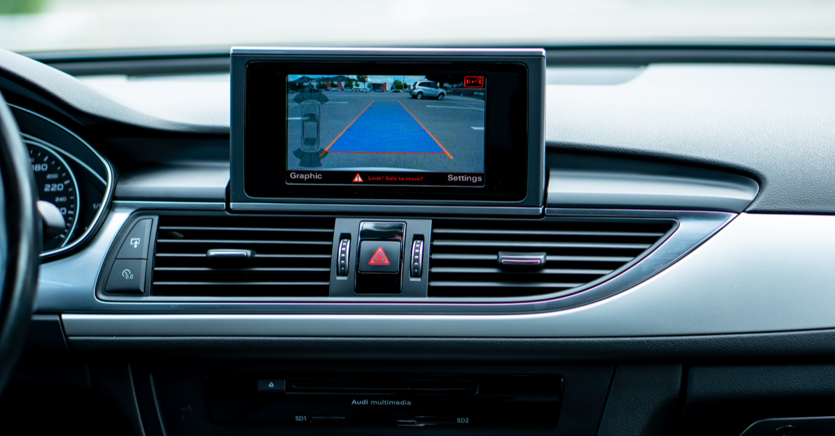 A backup camera is located on a car's dashboard area
