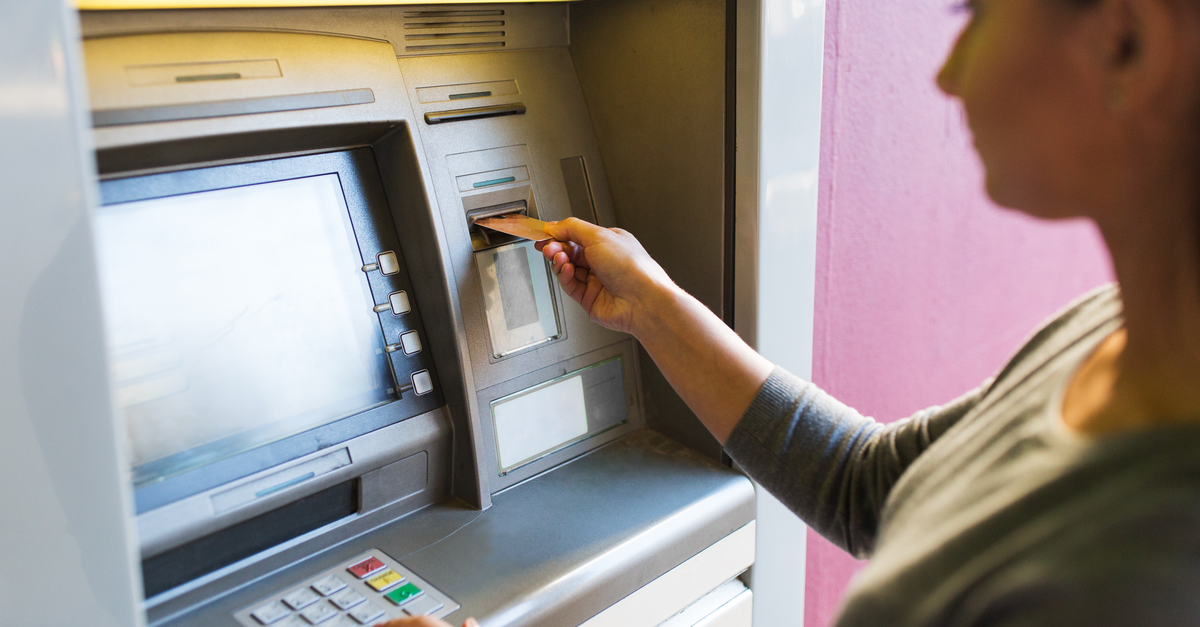 A woman uses an ATM for her banking needs