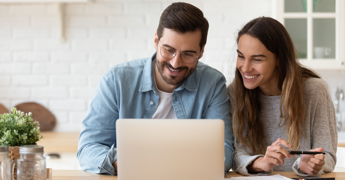 A couple reviews their savings account online