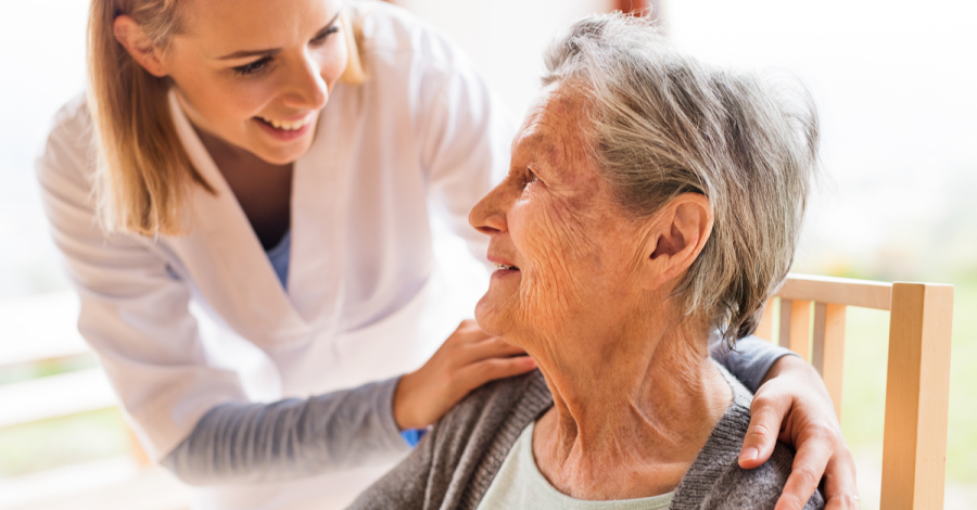 An in-home caregiver checks in on one of her patients