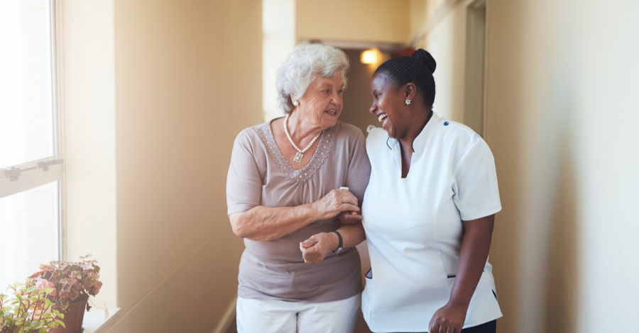 A caregiver and an assisted living resident enjoy a moment together